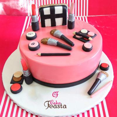 Makeup Kit On Pink Cake